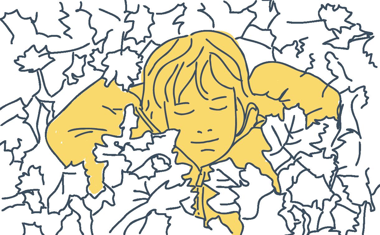 boy lying in fallen leaves